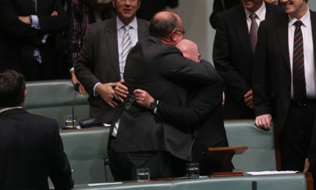 The Member for Moore Dr Mal Washer disappears in a bear hug from Warren Entsch after giving his valedictory speech. The Global Mail.