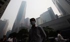 A Singapore office worker walks to work through smoke haze