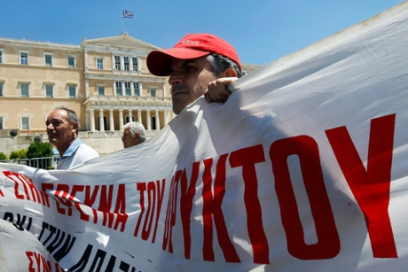 Employees of state organisations in danger of dismissal demonstrate in front of the Parliament Building, in Athens, Greece, 19 June 2013.