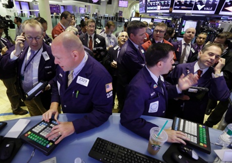 Traders gather at posts on the floor of the New York Stock Exchange Wednesday, June 19, 2013.