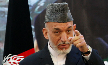 US races to mollify Hamid Karzai over plans for peace talks with Taliban...