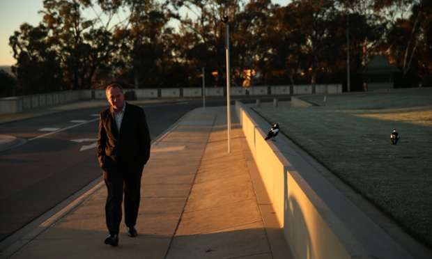 Senator Barnaby Joyce takes a morning constitutional around Parliament House in Canberra. The Global Mail.