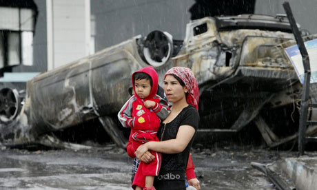 A Uighur woman and child in Urumqi after the 2009 violence.