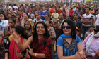 Indian women dance in an event to support the One Billion Rising global campaign