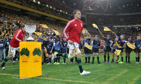 Sam Warburton leads the Lions out.