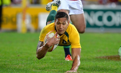 Israel Folau of the Wallabies scores.