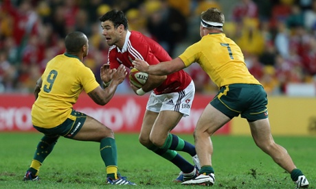 Mike Phillips is tackled by Australia's Will Genia and Michael Hooper.