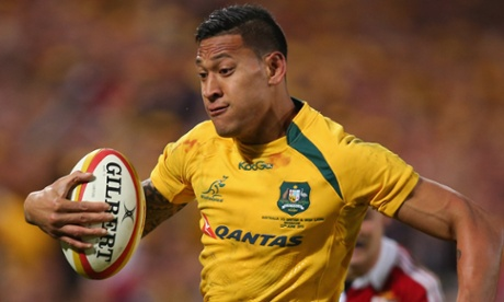 Israel Folau makes a break to score his second try.
