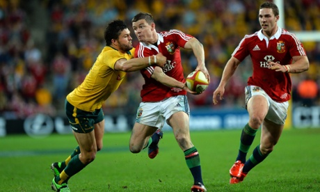 Brian O'Driscoll tries to pass around Adam Ashley-Cooper.
