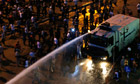 A water cannon sprays protesters during clashes in Taksim Square, Istanbul