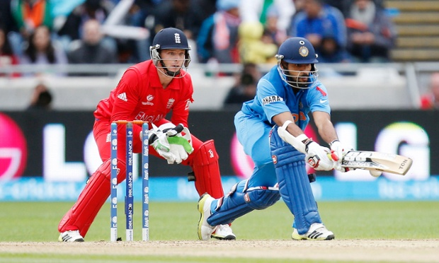 Jos Buttler keeps his eye on Shikhar Dhawan.