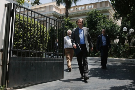 Greece's Prime Minister's Antonis Samaras leaving his office in Athens June 24, 2013