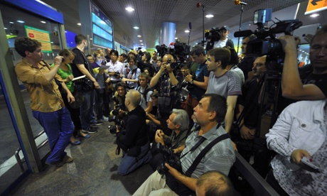 Journalists in Moscow await the arrival on Sunday of Edward Snowden from Hong Kong. But Snowden was reported not to have been on an Aeroflot plane bound for Havana.