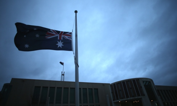 The flags around Parliament House Canberra fly at half mast this morning in honour of the memorial service for former first lady Hazel Hawke. The Global Mail.