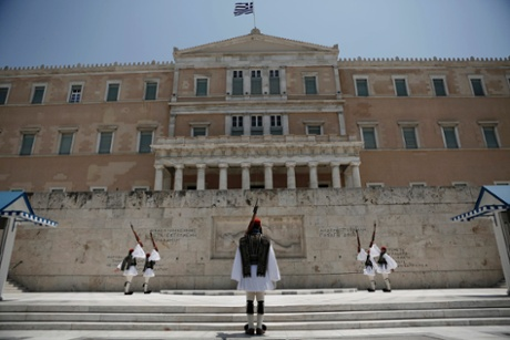 Greek Presidential guards perform a change of shift in front of the parliament in Athens June 24, 2013.