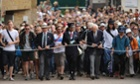 Fans arrive during day two of the Wimbledon Championships.