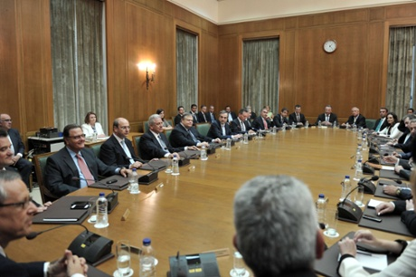 Ministers attend the first cabinet meeting after the swearing-in ceremony of the new government in Athens on June 25, 2013.