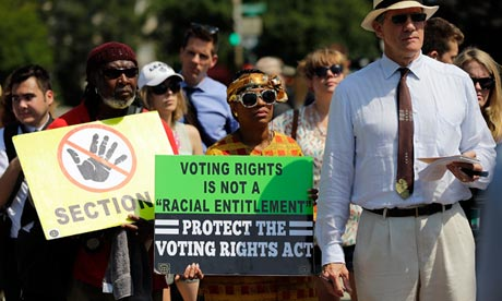Supporters of the Voting Rights Act listen to speakers outside the supreme court. Photograph: Win Mcnamee/Getty Images
