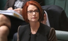 The Prime Minister Julia Gillard takes her seat in the House of Reps chamber in Parliament House, Ca