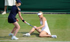 Maria Sharapova slips at Wimbledon on her way to defeat to Michelle Larcher de Brito