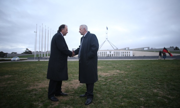 Bruce Hawker and Senator Doug Cameron on the lawns outside Parliament House, Canberra. The Global Mail.