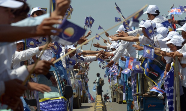 Cambodian supporters of Cambodia National Rescue Party (CNRP) wave during the start of the general election campaign in Phnom Penh.