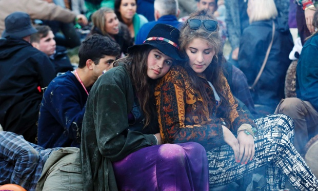 Festival-goers at the stone circle in the early morning.