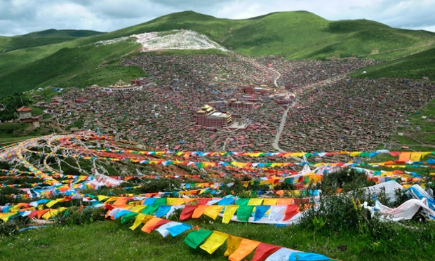 The sprawling hillside settlement of Larung Gar, home to Serthar Buddhist Institute, in the traditional Tibetan region of Kham. Thousands of tiny homes sprawl up a mountainside forming one of the world's largest Buddhist Institutes.
