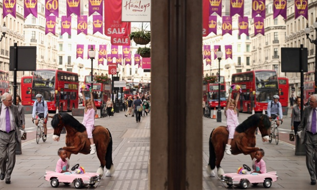 Lottie, 5, rides a Clydesdale Prancing Pony outside Hamleys toy shop. The soft toy pony retails for £850 GBP and is included in Hamleys' predictions for the top selling toys for Christmas 2013.