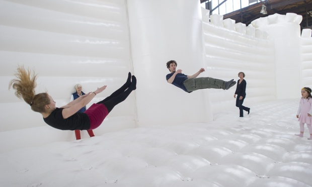 Visitors jump in the 'White Bouncy Castle' which will be open to visitors at Lokhalle Schoeneberg until 14 July.