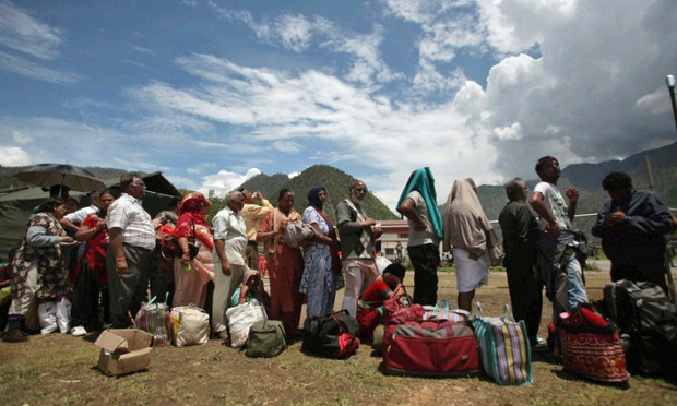 Rescued pilgrims wait for a helicopter in Gaucher, in the northern Indian state of Uttarakhand. Authorities in northern India today conducted mass cremations of hundreds of people who were killed by devastating floods and landslides that struck nearly two weeks ago.