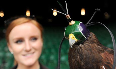 Rufus the hawk wears his hood in Wimbledon colours, with his handler Imogen Davies