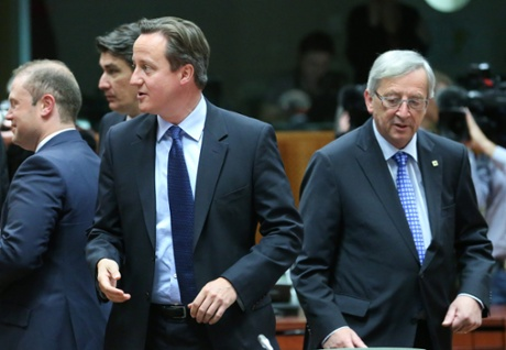 epa03763157 British Prime Minister David Cameron and Luxembourg's Prime Minister Jean-Claude Juncker (R) during a European Council summit in Brussels, Belgium, 27 June 2013