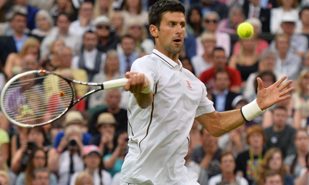 Novak Djokovic returns against Bobby Reynolds.
