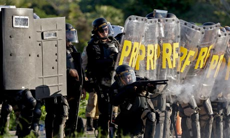 Riot police fire rubber bullets at protesters near Castelao stadium in Fortaleza