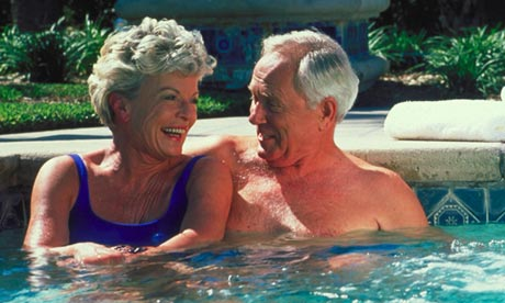 Couple sitting in a swimming pool