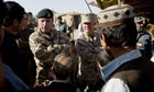General Nick Carter (L) chats with Afgan men in Helmand province in Afghanistan in 2009