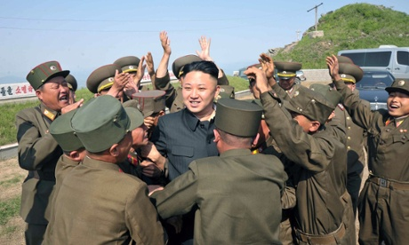 North Korean leader Kim Jong-Un is greeted by soldiers as he inspects watch posts in the Kangwon province of North Korea.