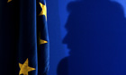 Silouette against EU flag
