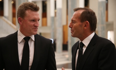 Leader of the Opposition Tony Abbott talks with Collingwood coach Nathan Buckley at the AFL Hall of Fame induction dinner in Parliament House Canberra. The Global Mail.