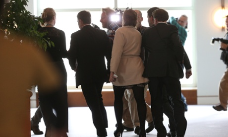 The media pack pursue Joel Fitzgibbon through the Mural Hall. The Global Mail.