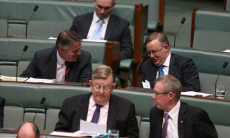 The Leader of the House Anthony Albanese visits the cross benches during Question Time.