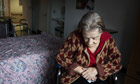 Elderly woman sits in her room at a nursing home.