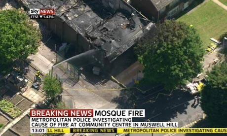 Firefighters attempt to control the blaze at an Islamic centre in north London