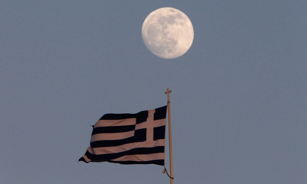 A Greek flag flutters on the top of the parliament as the moon rises in Athens May 23, 2013.