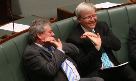 Kevin Rudd and Sid Sidebottom wave to schoolchildren visiting the chamber during a division in the House of Representatives this morning. The Global Mail.