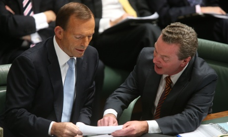 The Leader of the Opposition Tony Abbott confers with the Manager of Opposition Business Christopher Pyne during Question Time. The Global Mail.