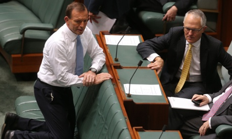 The Leader of the Opposition Tony Abbott talks with Shadow Minister for Broadband Malcolm Turnbull. The Global Mail.
