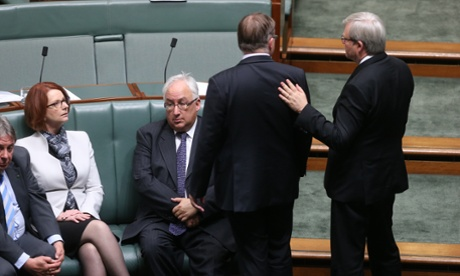 The Prime Minister Julia Gillard looks up at the Member for Griffith Kevin Rudd during a division. The Global Mail.