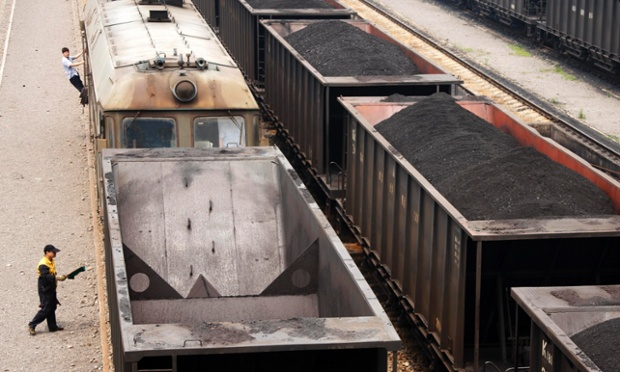 Freight trains are loaded with coal in Huaibei, Anhui province. China is considering plans to cut coal consumption in some major industrial regions in an effort to reduce air pollution.